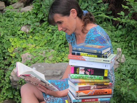 Not a mystery spot: Me in my backyard, last summer, for DC Library's #mysummerreadingspot